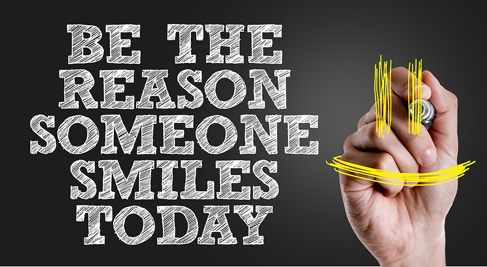 Photo of Hand writing the text: Be The Reason Someone Smiles Today