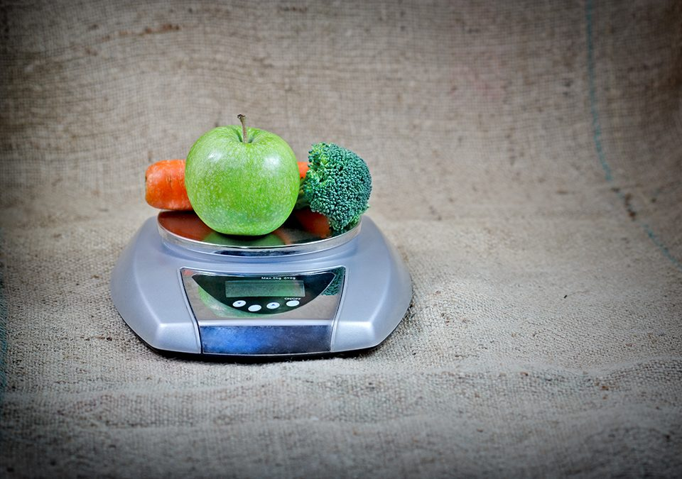 Photo of fruits and vegetables sitting on a scale